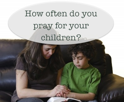 mom and son praying